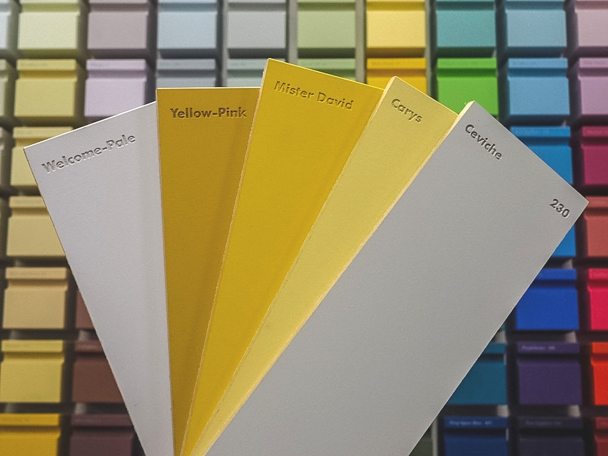 A selection of Little Greene paints in yellow and grey