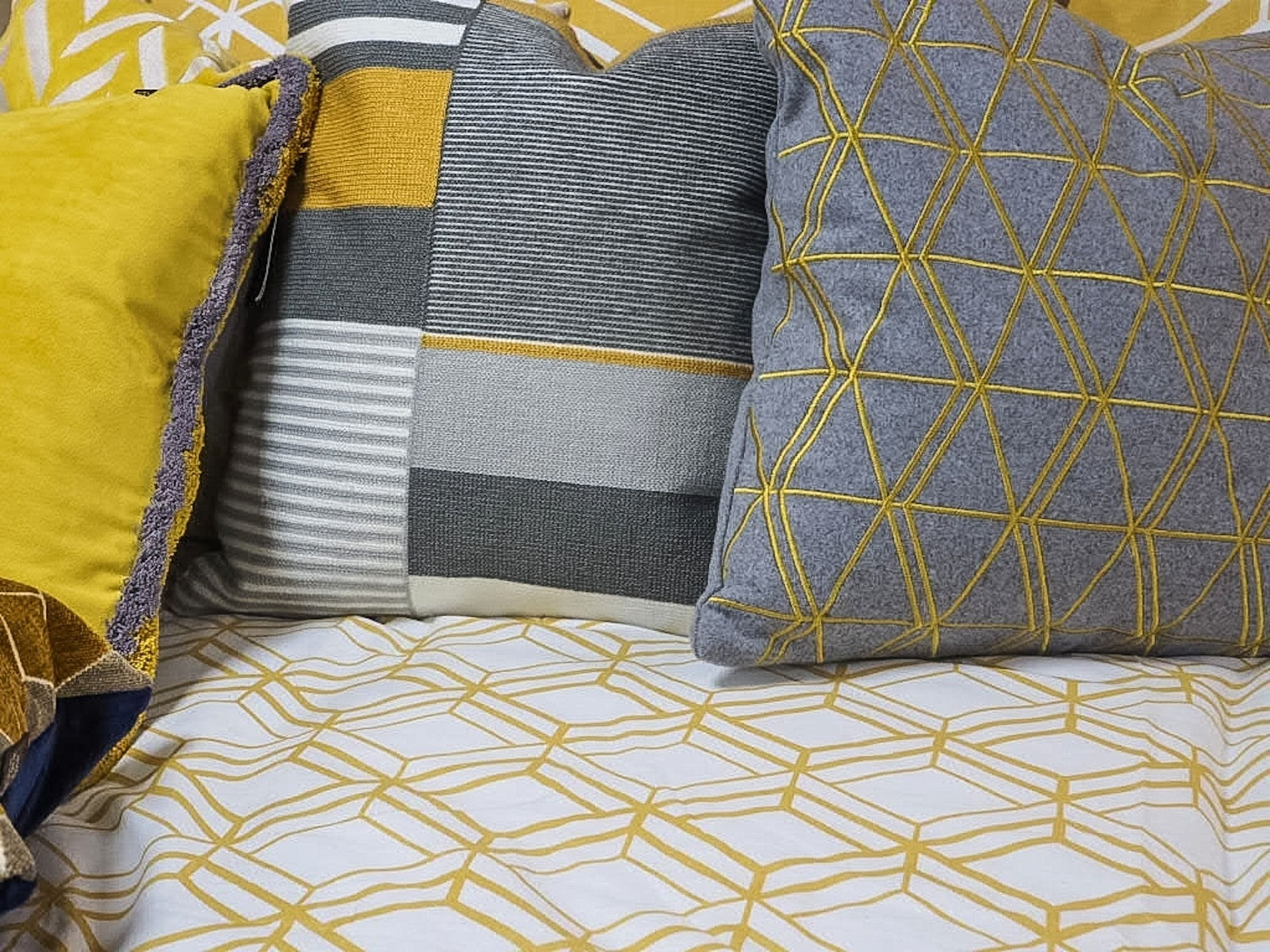 Ludwig Mustard Throw Pillow, Milana Yellow Throw Pillow, Linear Crewel Stitch Mustard Throw Pillow, and Catherine Lansfield Double Duvet Set